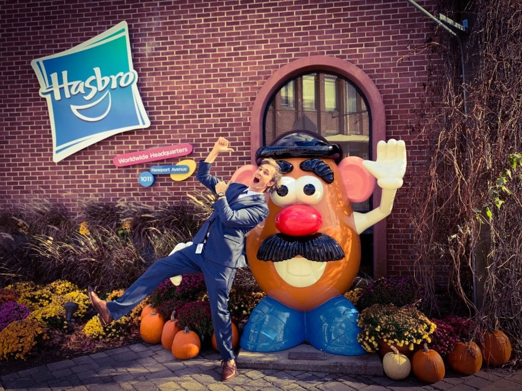 Gray Bright dancing out front of Hasbro Head Office in Pawtucket, Rhode Island with Mr Potato Head in a suit.