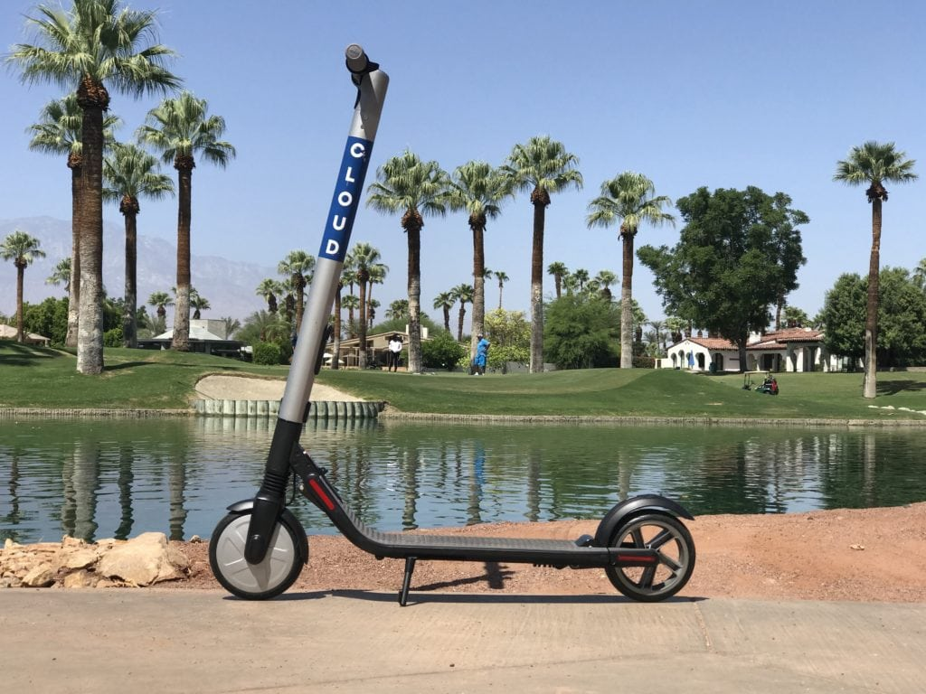Cloud Scooter standing by a lake in Palm Springs