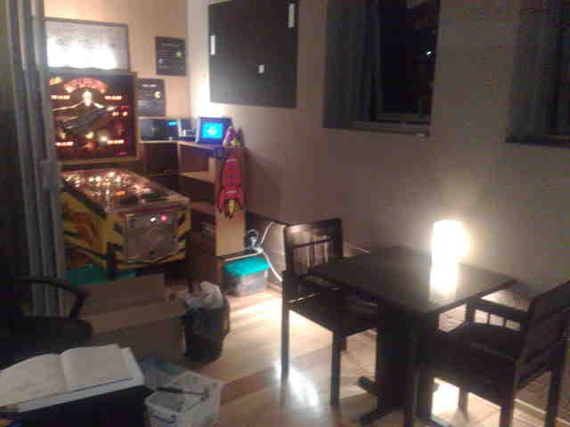 Gray Bright Sydney Apartment with pinball machine and PONG artwork from Atari