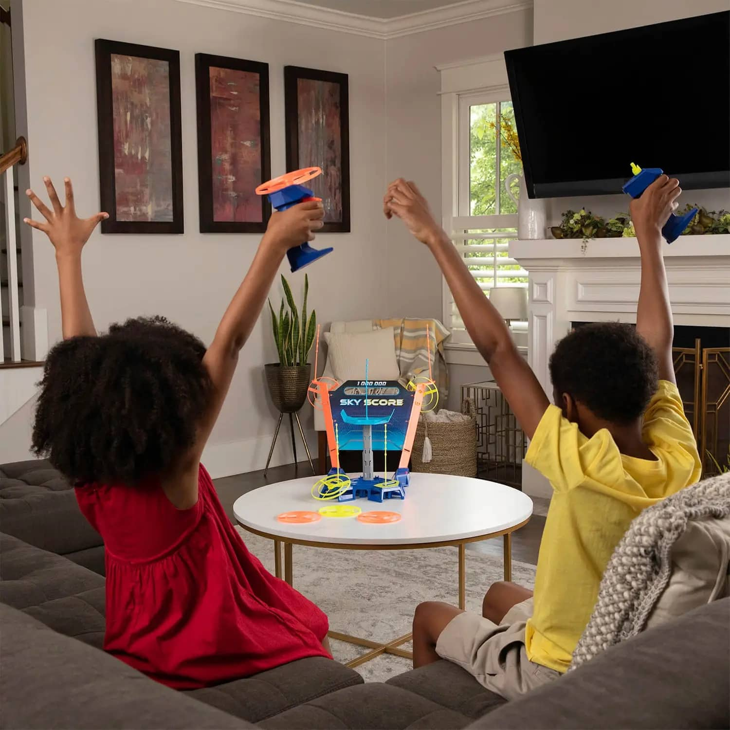 Sky Score Game Hasbro kids in lifestyle shot playing the game and celebrating